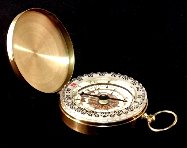 Picture of a brass compass on a black background ... which links to the theme of having a goal and direction